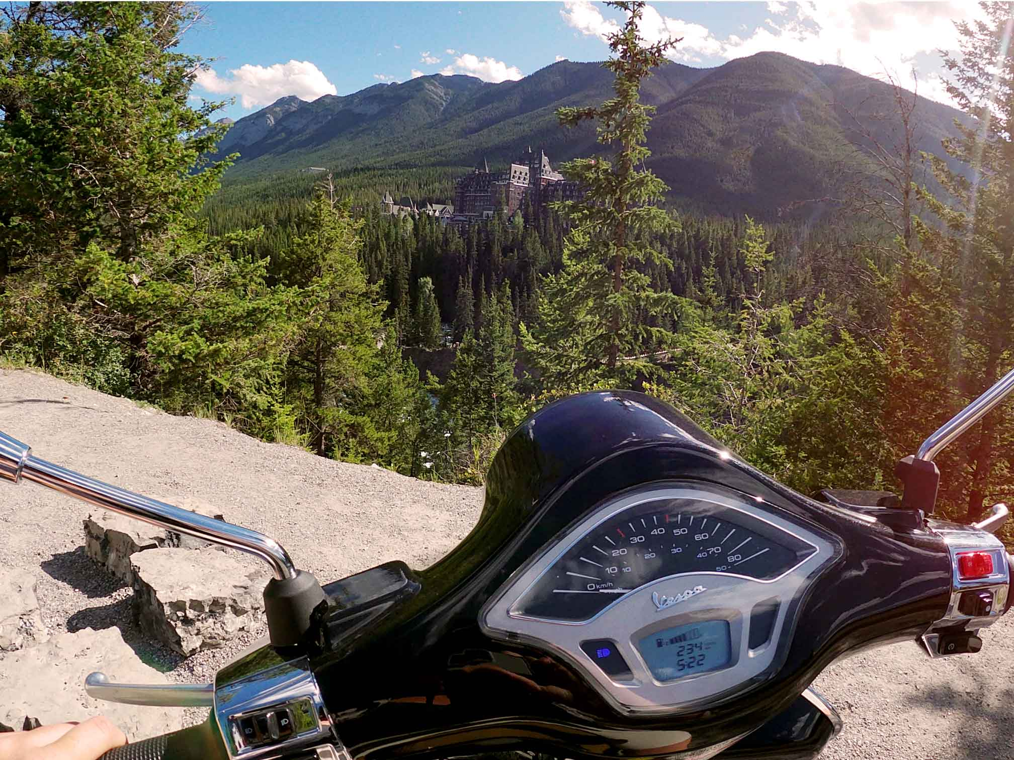 Banff By Scooter Vespa overlooking the Fairmont Banff Springs