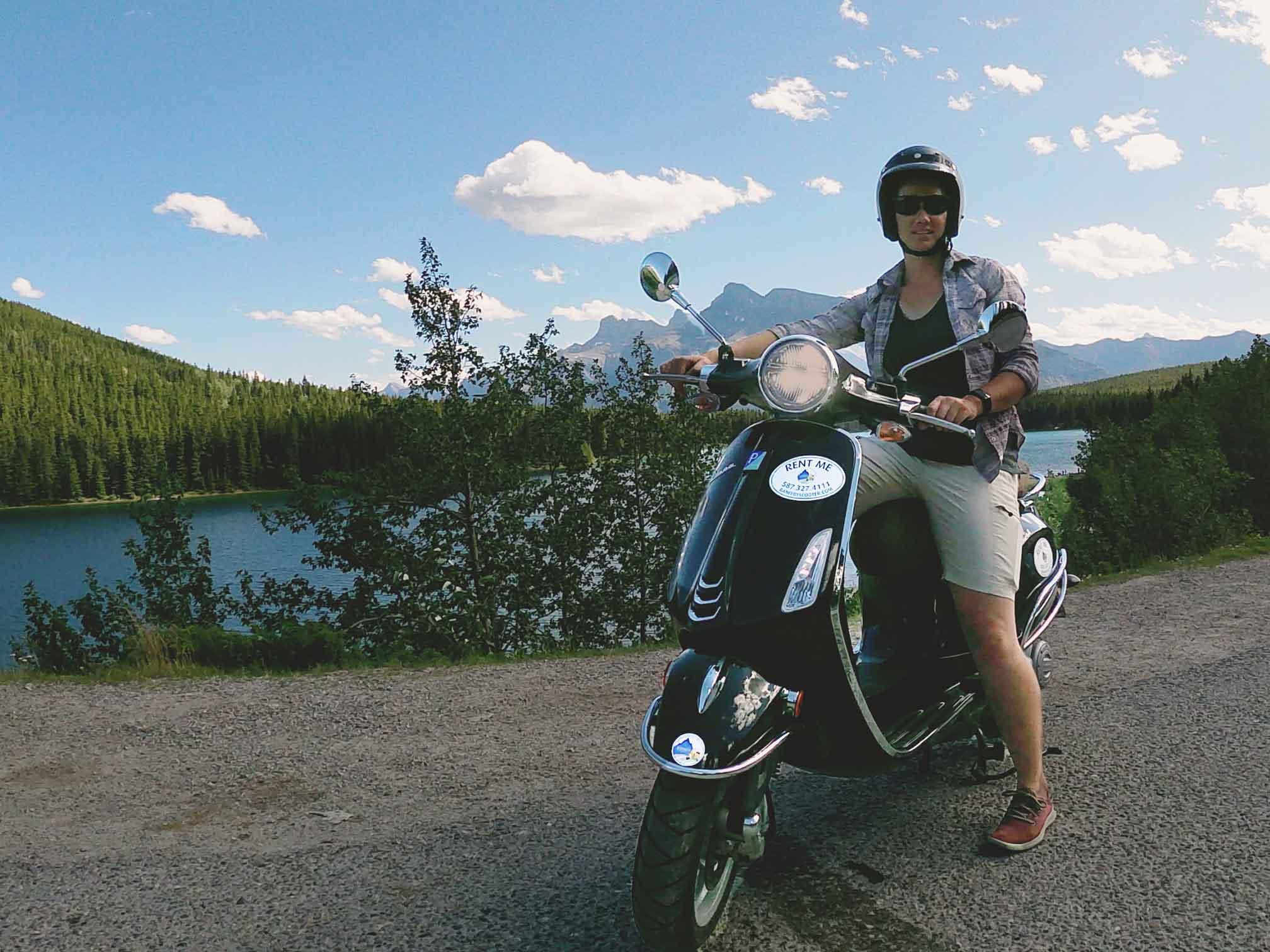 Riding a Vespa at Lake Minnewanka with Banff By Scooter