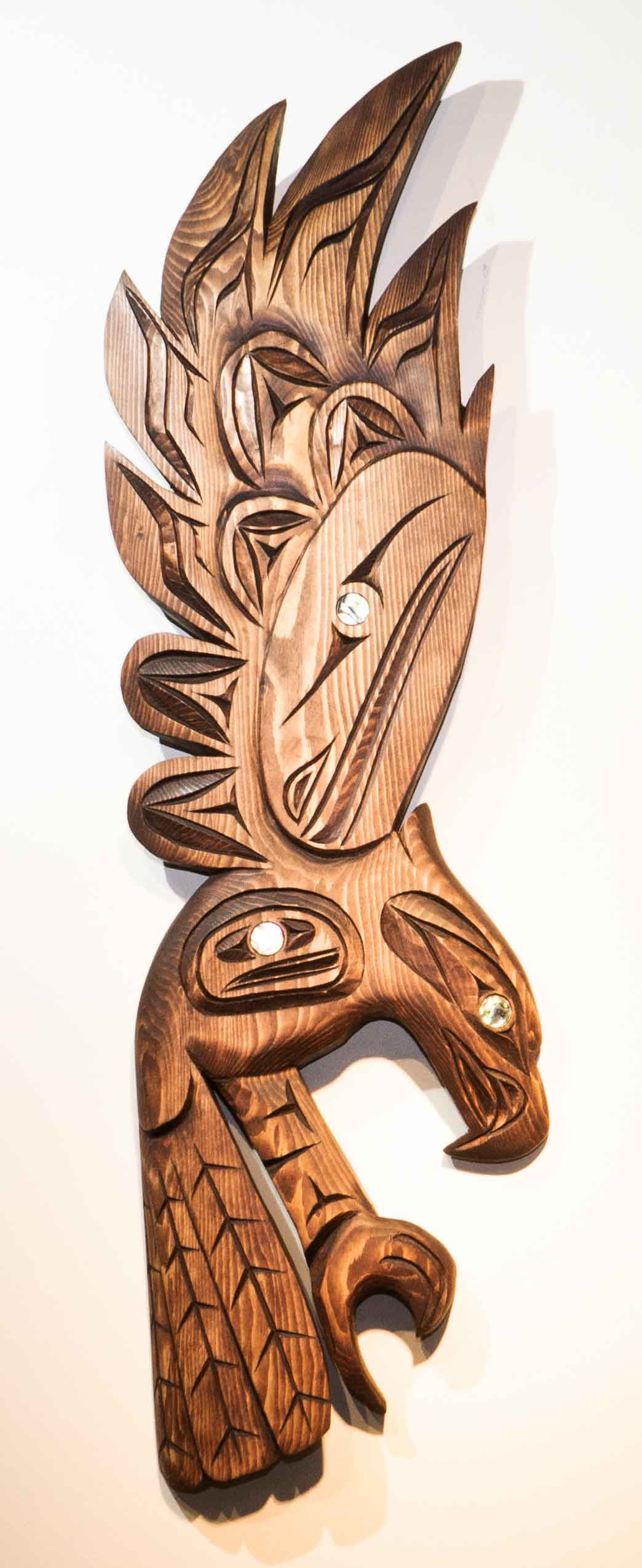 Our Native Land wood eagle sculpture by Brian Bob