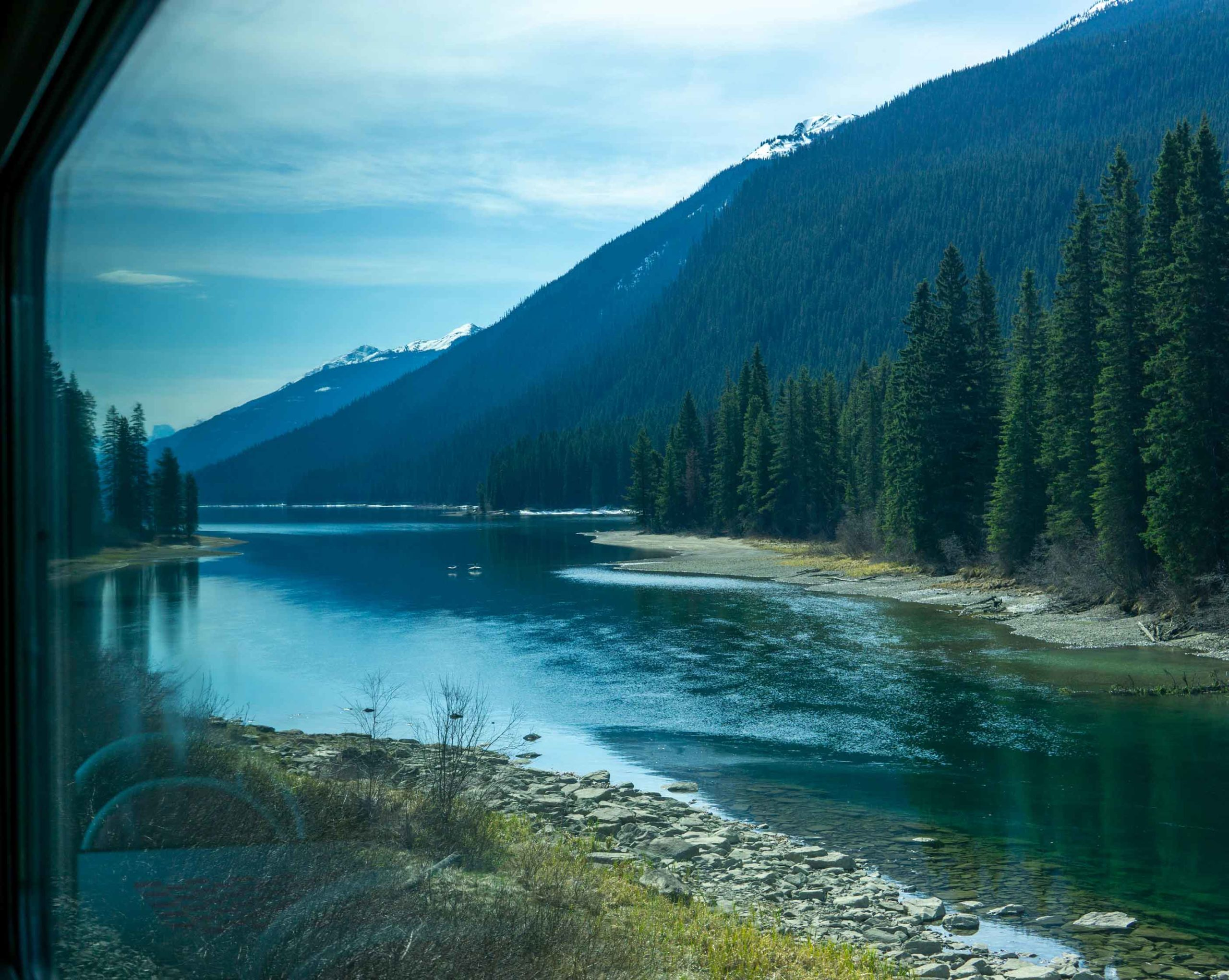Looking through the window of the train at the Rockies aboard The Canadian