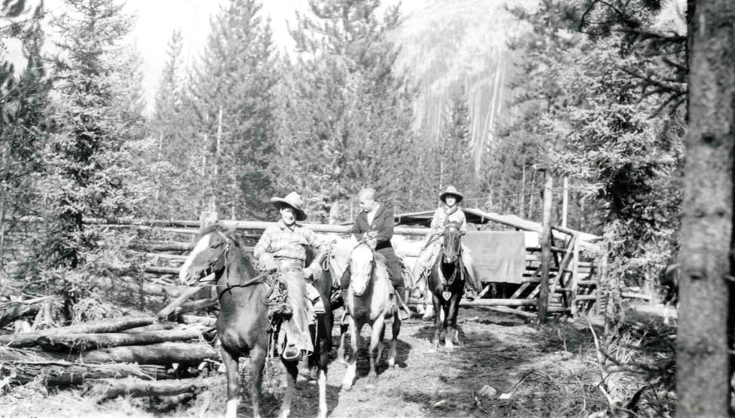 Photograph: (L to R) Agnes Truxler (Harragin), Mr. Glassbrenner, Mona Matheson (Harragin) on horseback at camp. Jasper Yellowhead Museum and Archives (001.14.01.01.03)