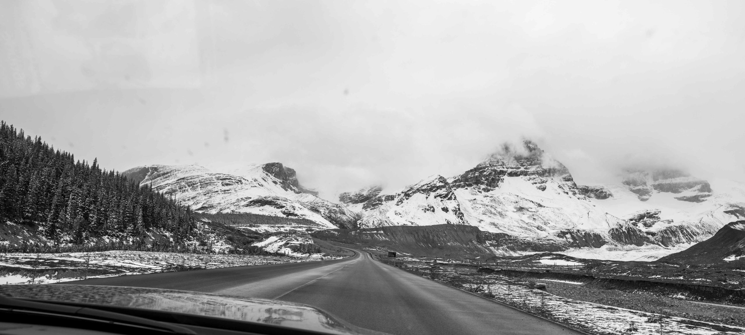 Driving through the Canadian Rockies road view as seen by the passenger seat by Jack Hawkins