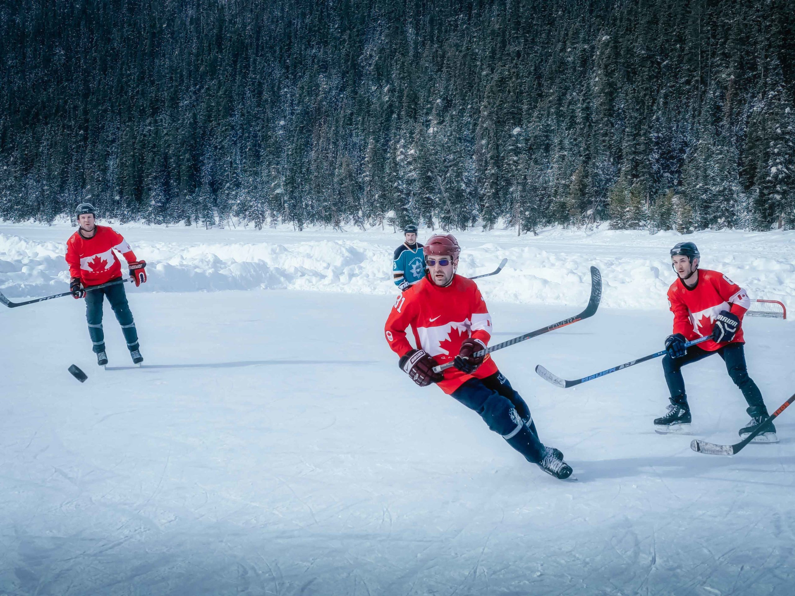 Hockey Players at the Pond Hockey Classic in Lake Louise captured using burst mode on a smartphone as part of Sanjay Chauhan's series on photography tips for your phone