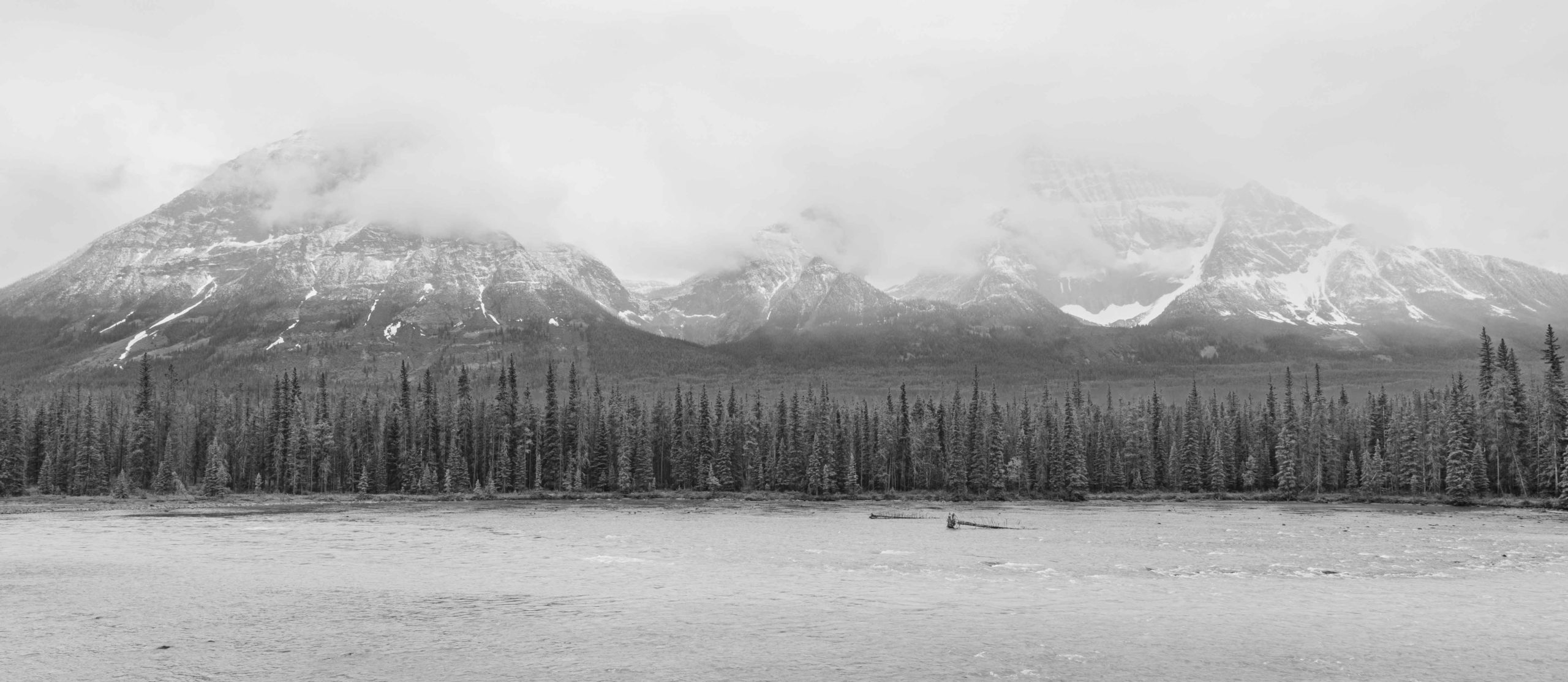 Mountain scenery while driving through the Canadian Rockies by Jack Hawkins