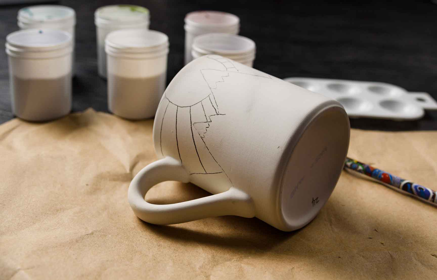 Drawing the design on the mug from Crock A Doodle in Canmore