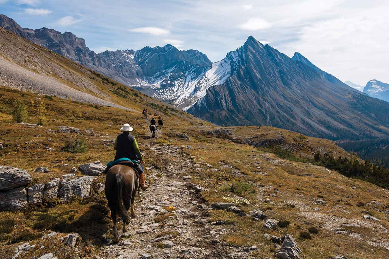 People ride into the backcountry on horseback