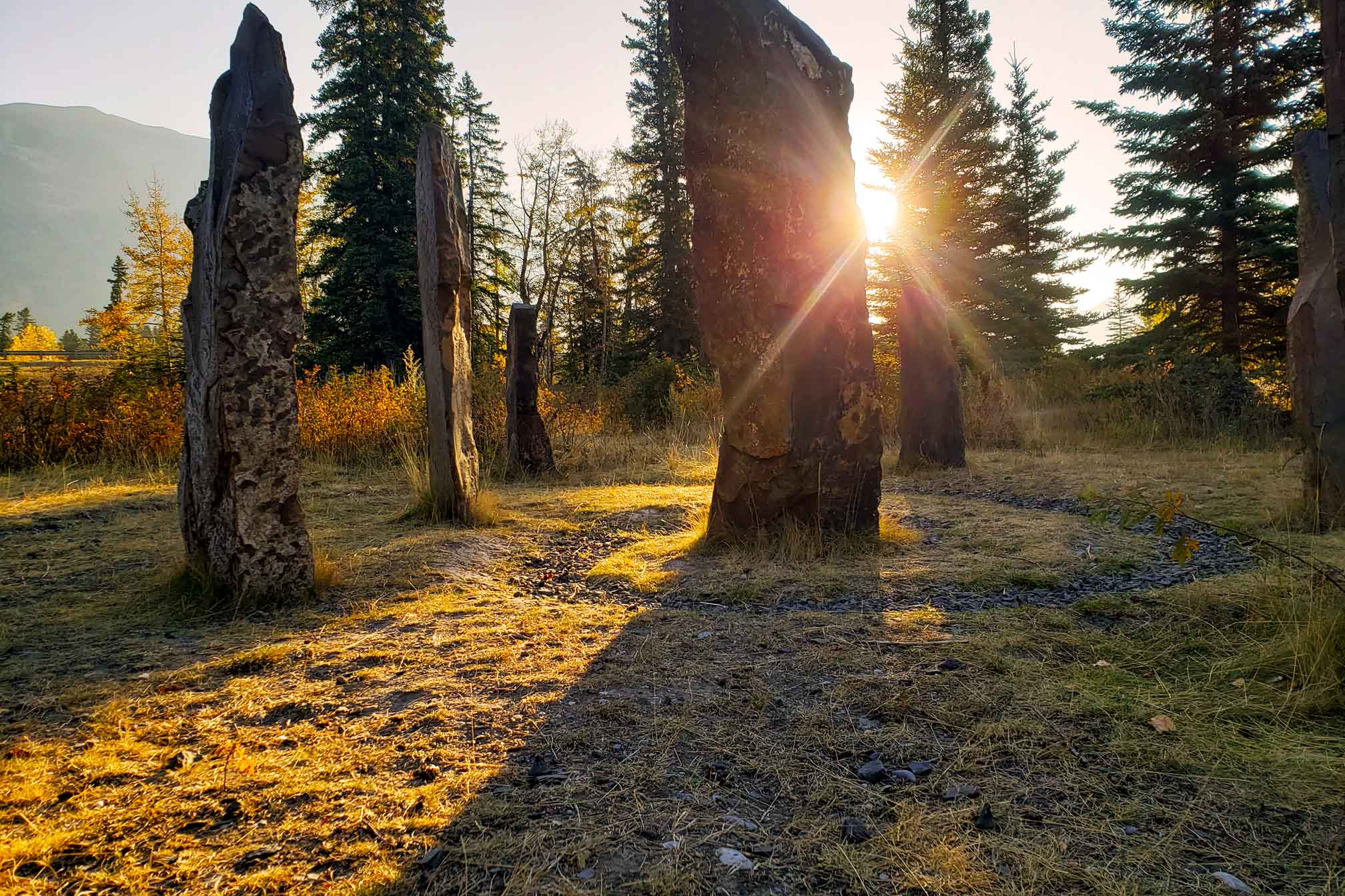Sun shines through the rocks of Portal, a public art in Canmore display
