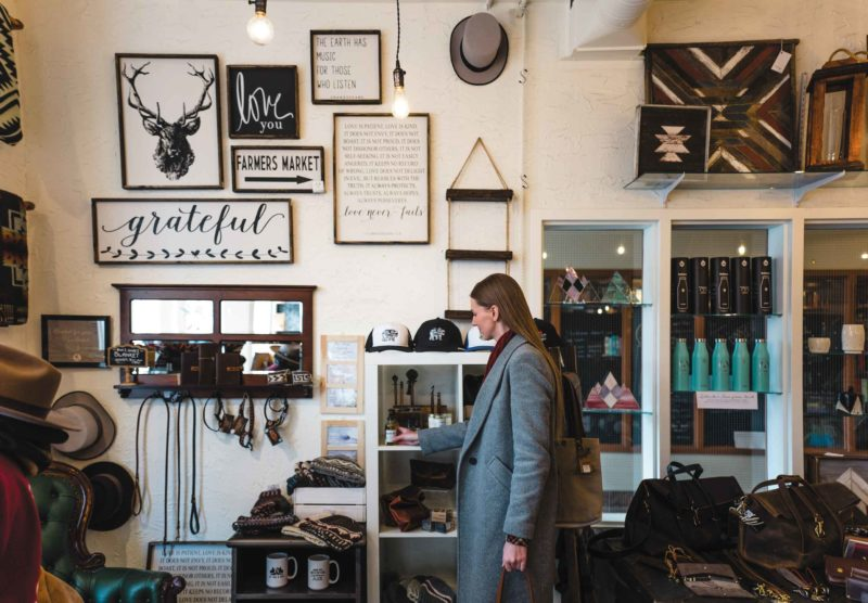 A woman in Alberta's Own Marketplace with unique, shop local gifts