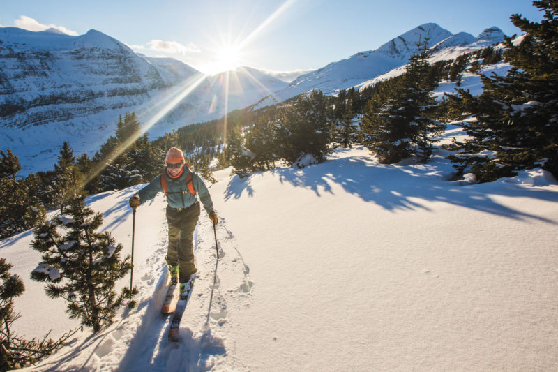 A woman ski touring in the mountains