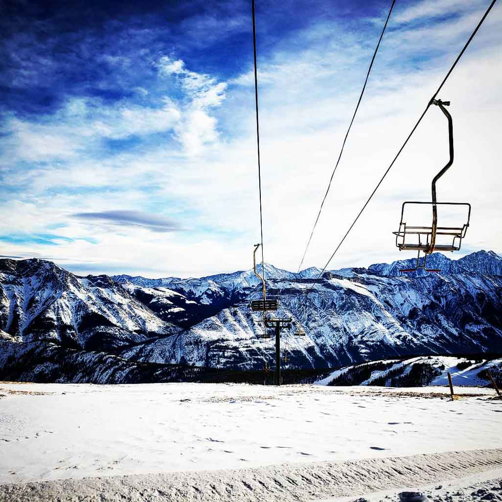 Chairlifts are frozen in front of mountain scenery at Fortress Mountain