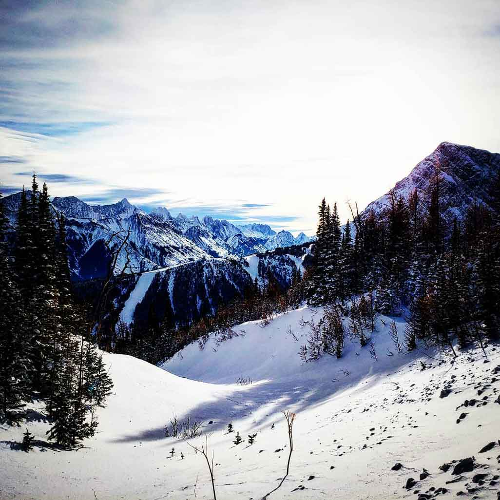 Mountains and fresh deep snow from the Snowcat Snowshoe Adventure