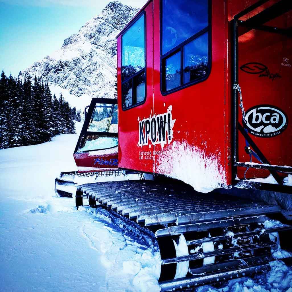 A KPOW Snowcat and mountain scenery