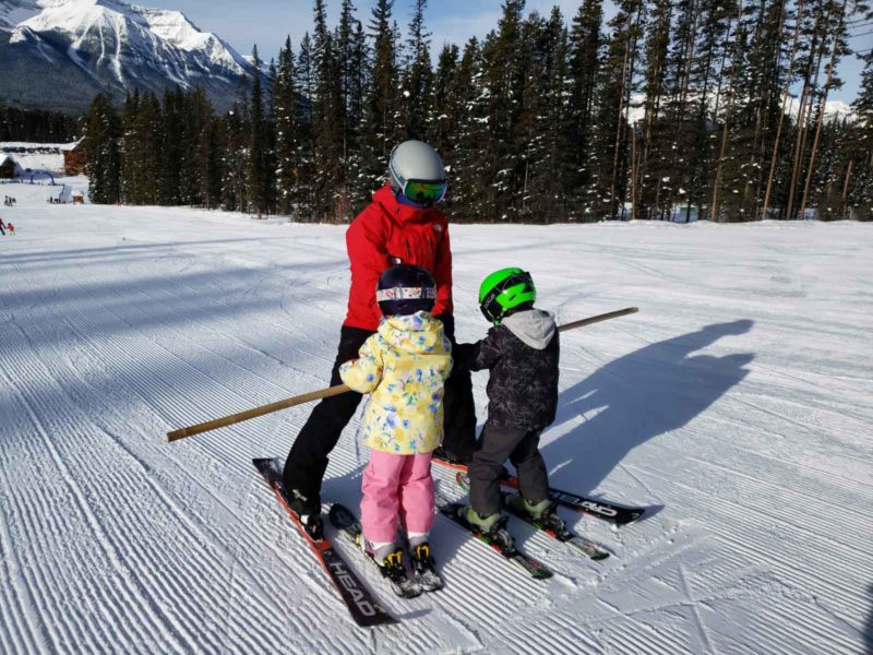 Jessica teaching the kids how to glide during their ski lesson at Lake Louise Ski Resort