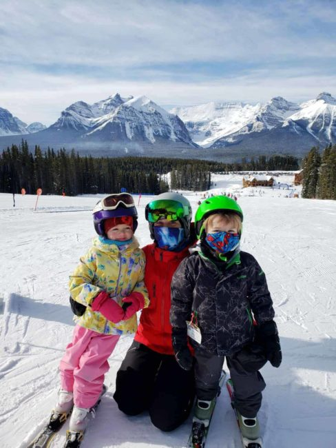 Jessica poses for a picture with the kids during their ski lesson at Lake Louise Ski Resort
