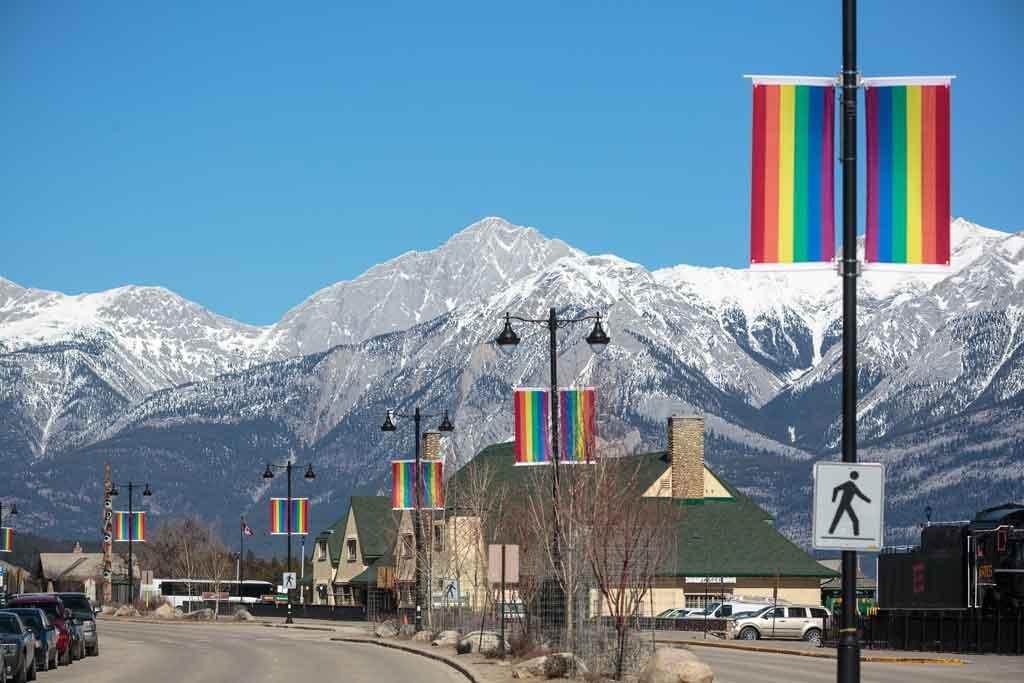 Rainbow flags line the street for Jasper Pride