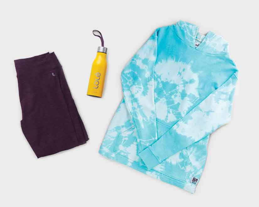 Mountain Style: Sweater, water bottle and sweat pants for sitting around a campfire