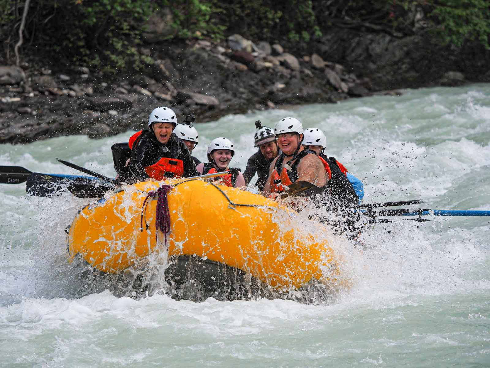 Whitewater rafting on the Kicking Horse River in Golden BC with Glacier Raft Company during summer in the Canadian Rockies