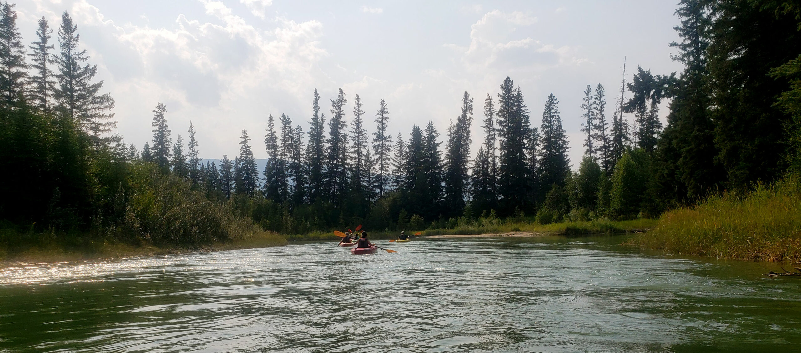 A group on a kayak tour from Fairmont Hot Springs Resort